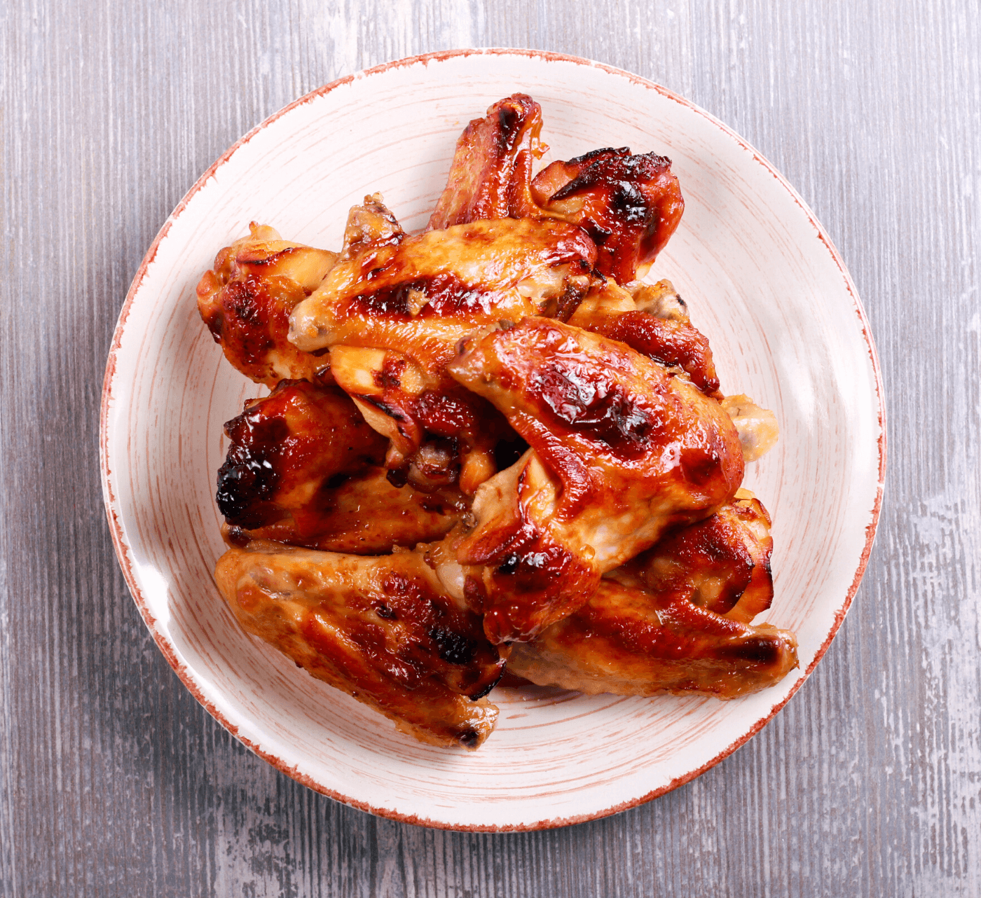 Plate of honey glazed wings.